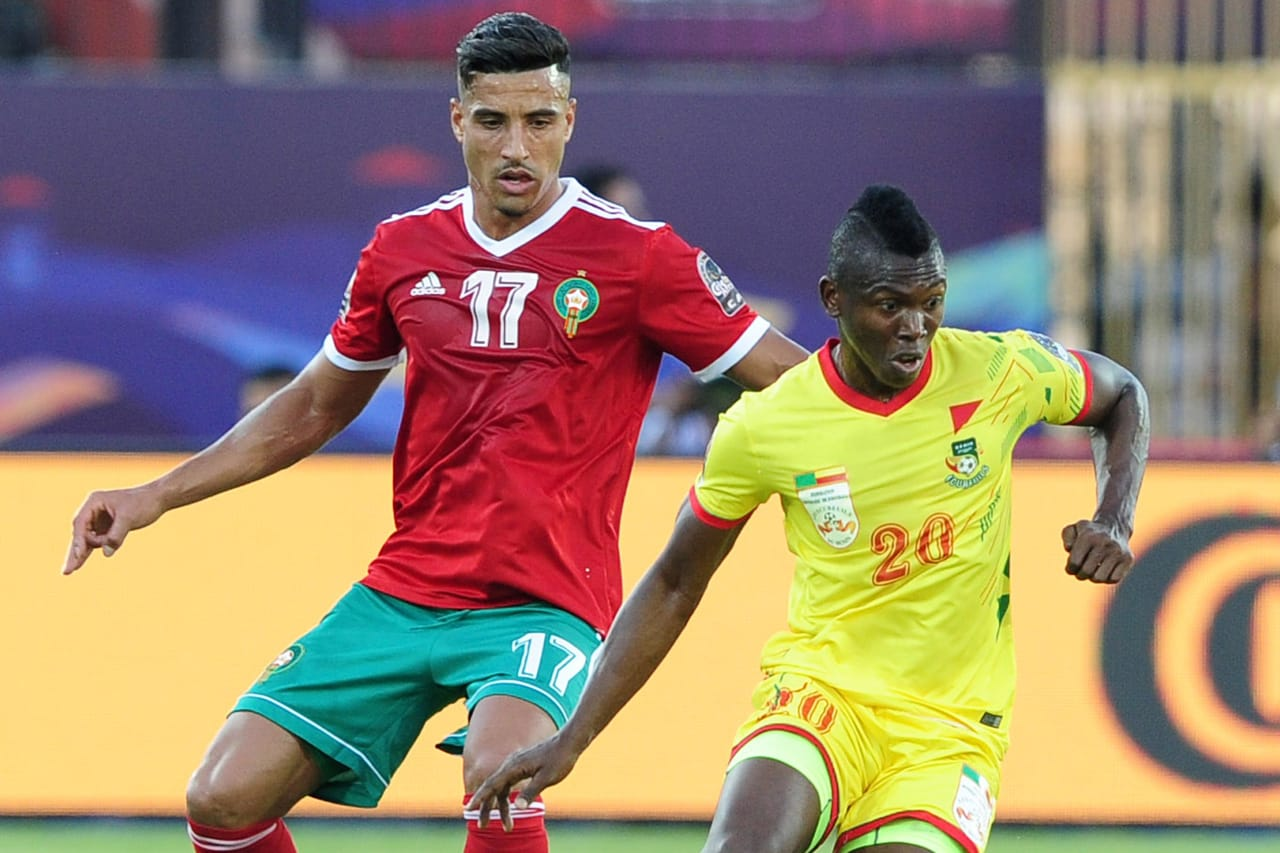Jodel Dossou of Benin turns away from Nabil Dirar of Morocco during the 2019 Africa Cup of Nations Finals last 16 match between Morocco and Benin at the Al Salam Stadium in Cairo, Egypt on 05 July 2019 © Ryan Wilkisky/BackpagePix
