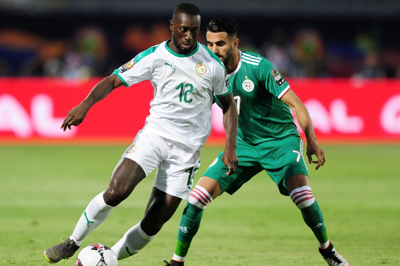 Youssouf Sabaly of Senegal is challenged by Riyad Mahrez of Algeria during the 2019 Africa Cup of Nations Finals match between Senegal and Algeria at 30 June Stadium, Cairo, Egypt on 27 June 2019 © Ryan Wilkisky/BackpagePix