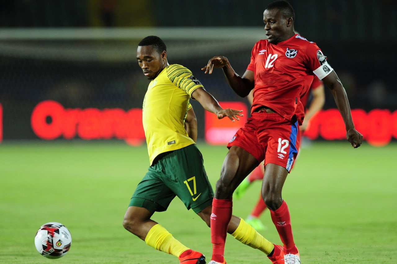 Sibusiso Vilakazi of South Africa is challenged by Ronald Ketjijere of Namibia during the 2019 Africa Cup of Nations Finals match between South Africa and Namibia at Al Salam Stadium in Cairo, Egypt on 28 June 2019 © Ryan Wilkisky/BackpagePix