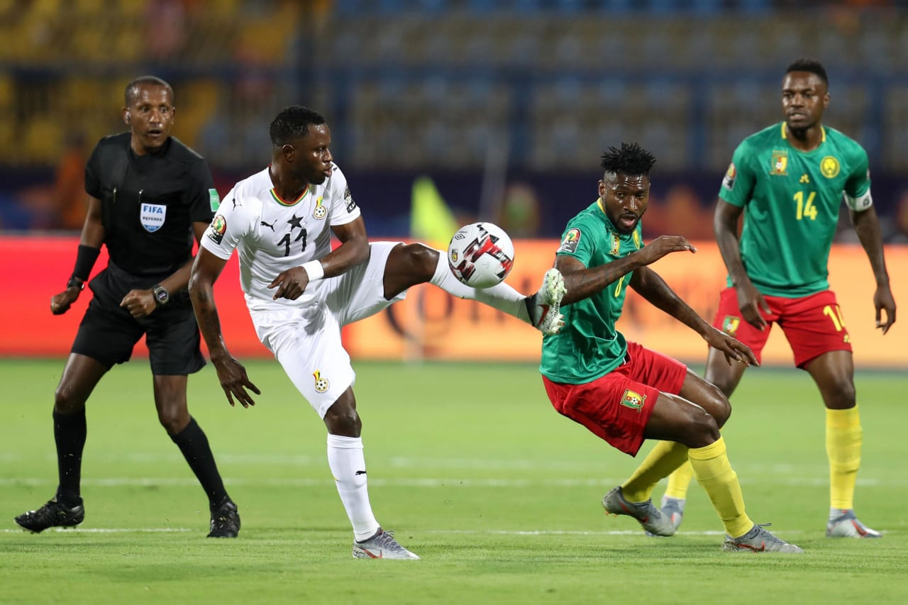 Mubarak Wakaso of Ghana challenged by Andre Frank Zambo Anguissa of Cameroon during the 2019 Africa Cup of Nations Finals Cameroon and Ghana at Ismailia Stadium, Ismailia, Egypt on 29 June 2019 ©Samuel Shivambu/BackpagePix