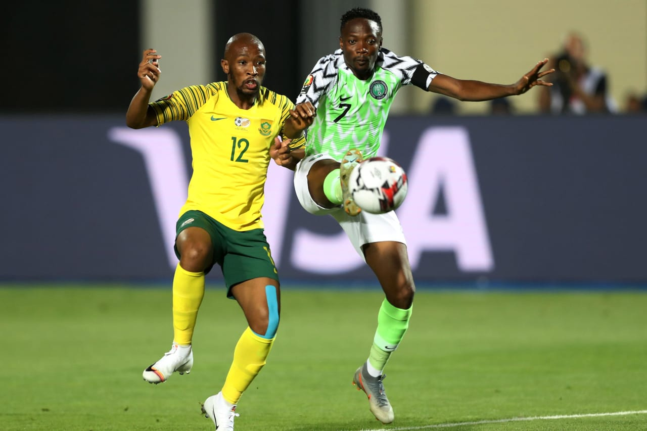 Ahmed Musa of Nigeria challenged by Kamohelo Mokotjo of South Africa during the 2019 Africa Cup of Nations Finals, quarterfinals match between Nigeria and South Africa at Cairo International Stadium, Cairo, Egypt on 10 July 2019 ©Samuel Shivambu/BackpagePix