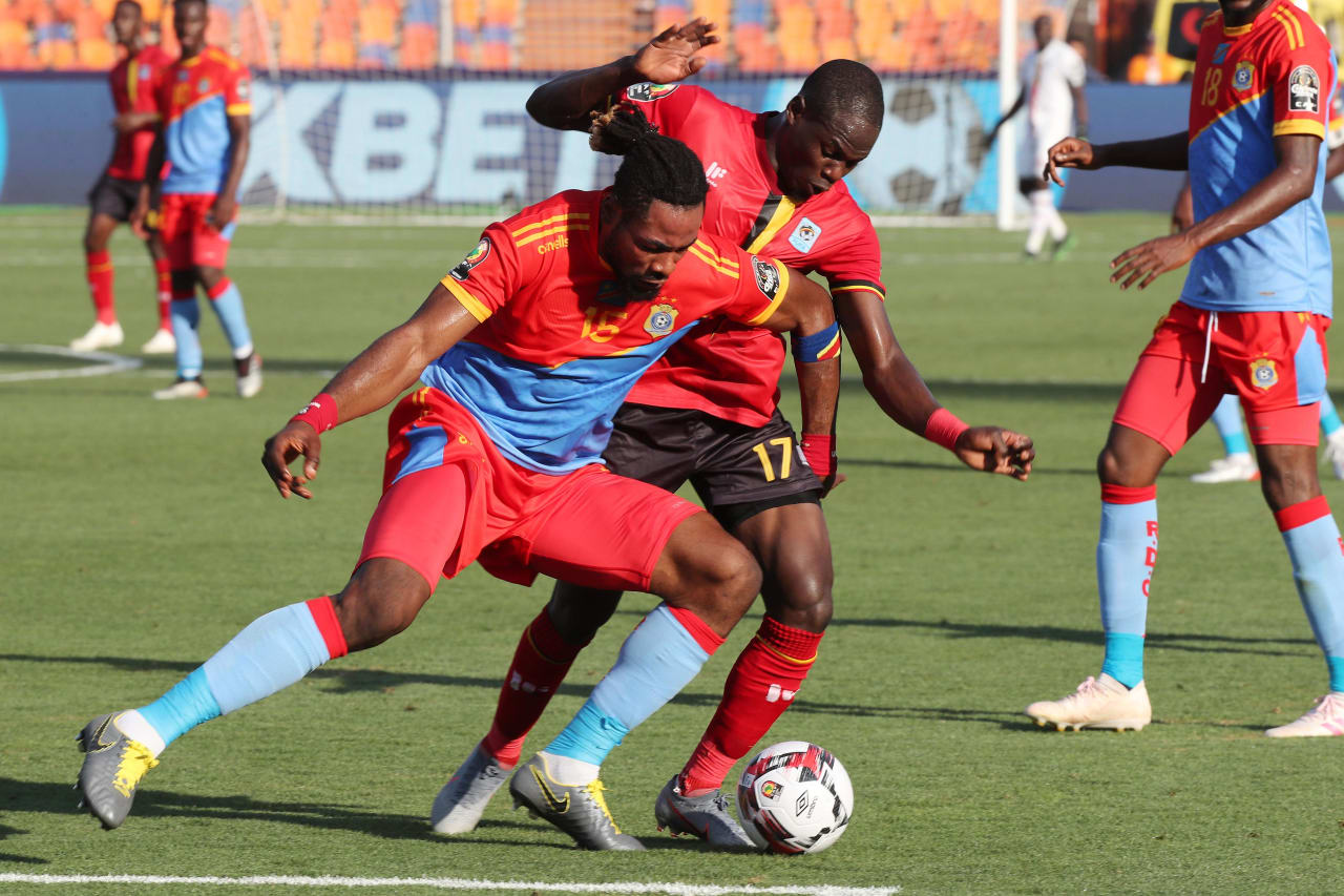 Christian Luyindama of DR Congo challenged by Faruku Miya of Uganda during the 2019 Africa Cup of Nations Finals football match between DR Congo and Uganda  at the Cairo International Stadium, Cairo, Egypt on 22 June 2019 ©Gavin Barker/BackpagePix