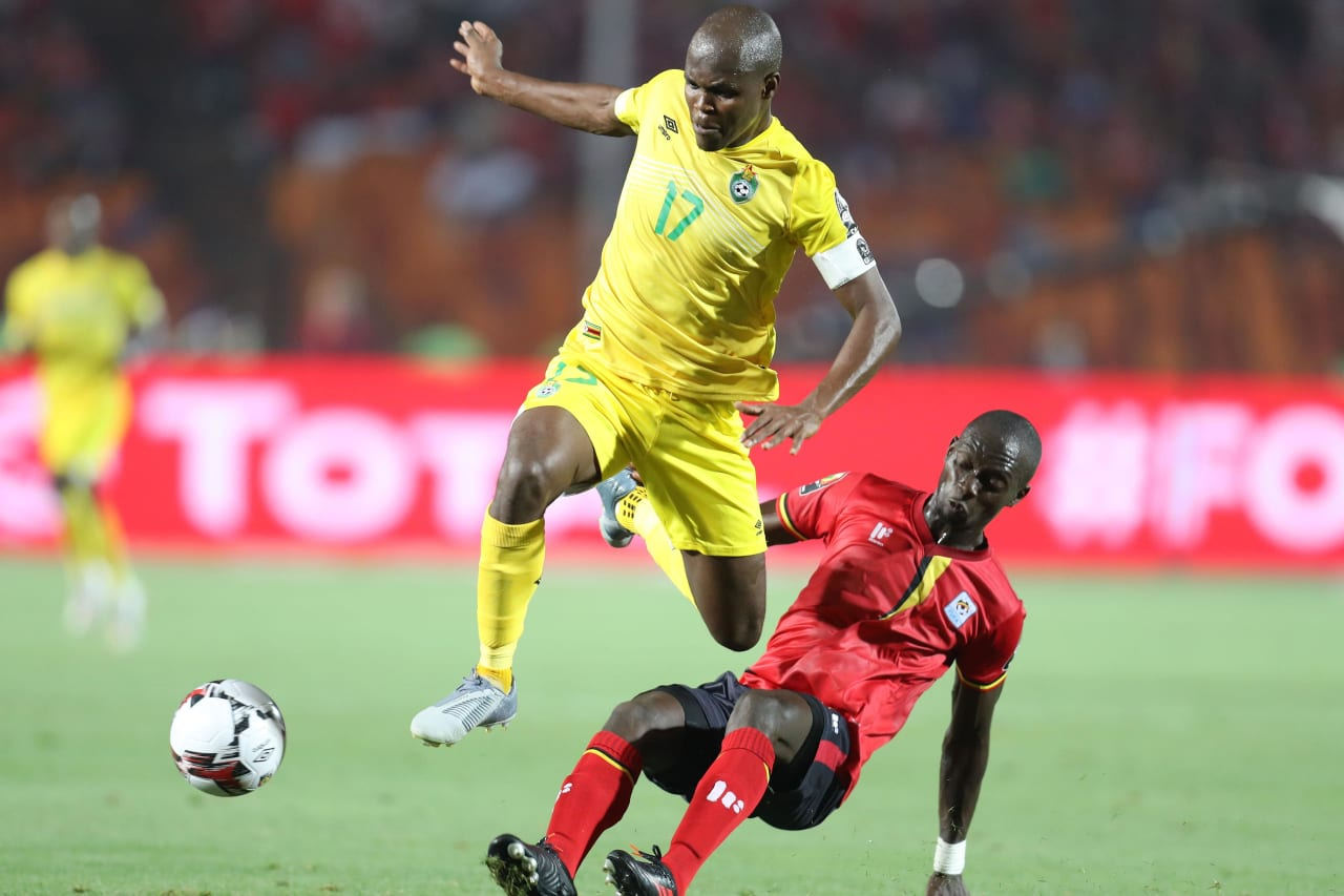 Knowledge Musona of Zimbabwe tackled by Michael Azira of Uganda during the 2019 Africa Cup of Nations Finals match between Uganda and Zimbabwe at Cairo International Stadium, Cairo, Egypt on 26 June 2019 ©Samuel Shivambu/BackpagePix