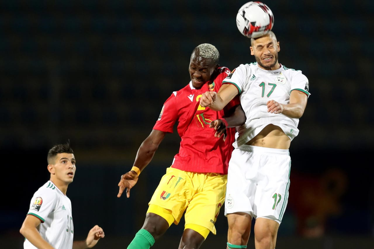 Adlane Guedioura of Algeria challenged by Mohamed Yattara of Guinea during the 2019 Africa Cup of Nations Finals last 16 match between Algeria and Guinea at 30 June Stadium, Cairo, Egypt on 07 July 2019 ©Samuel Shivambu/BackpagePix