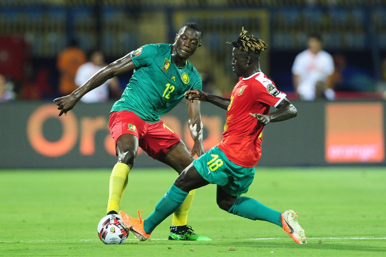 Joyskim Dawa Tchakonte of Cameroon is tackled by Piqueti of Guinea-Bissau during the 2019 Africa Cup of Nations Finals game between Cameroon and Guinea-Bissau at Ismailia Stadium in Ismailia, Egypt on 25 June 2019 © Ryan Wilkisky/BackpagePix