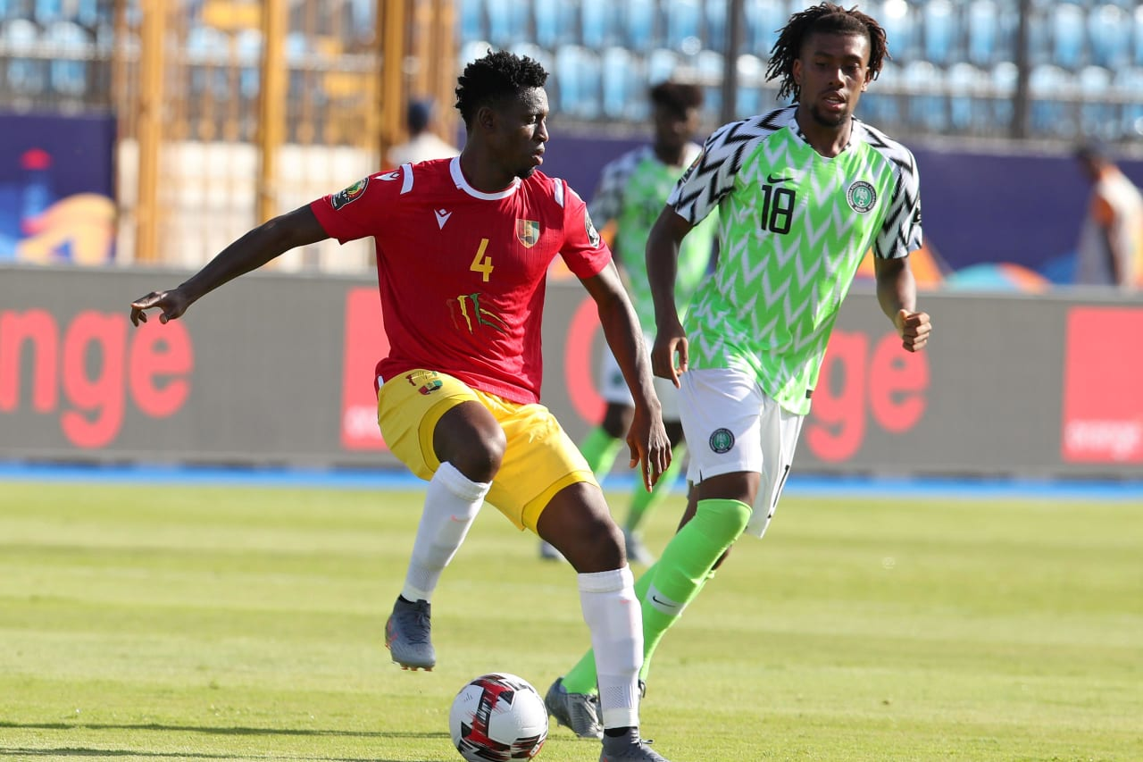 Amadou Diawara of Guinea challenged by Alexander Iwobi of Nigeria during the 2019 Africa Cup of Nations match between Nigeria and Guinea at the Alexandria Stadium, Alexandria on the 26 June 2019 ©Muzi Ntombela/BackpagePix