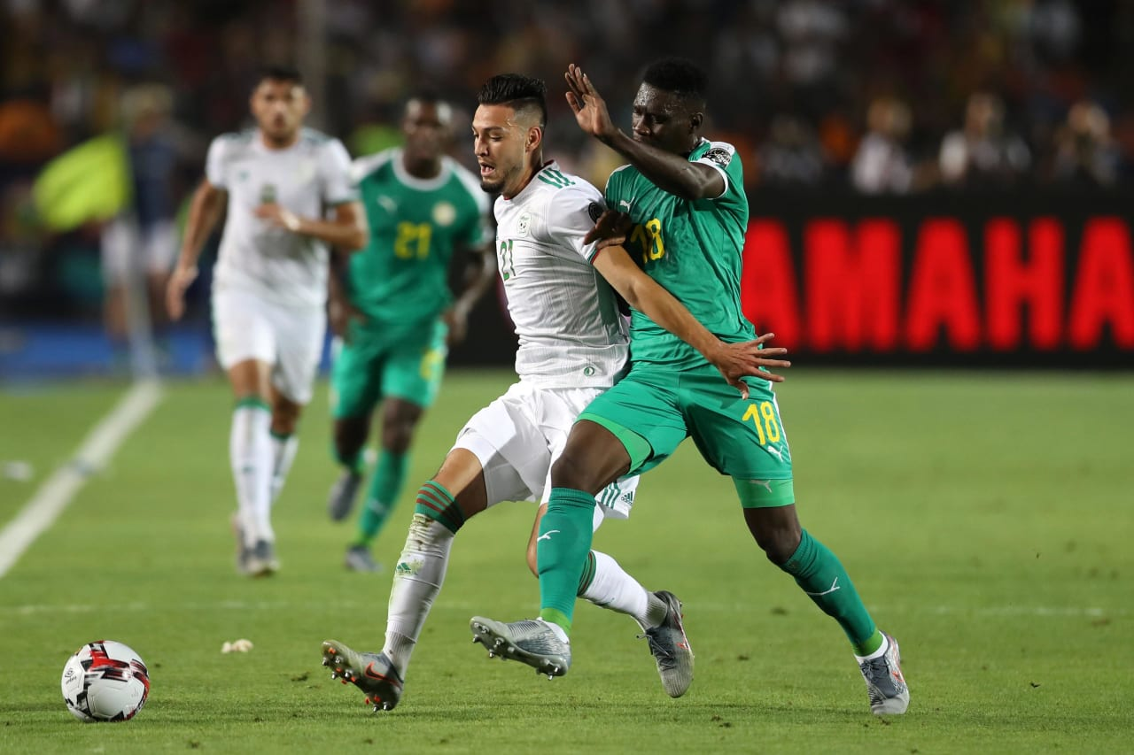 Ismaila Sarr of Senegal challenged by Rami Bensebaini of Algeria during the 2019 Africa Cup of Nations Finals, Final match between Senegal and Algeria at Cairo International Stadium, Cairo, Egypt on 19 July 2019 ©Samuel Shivambu/BackpagePix
