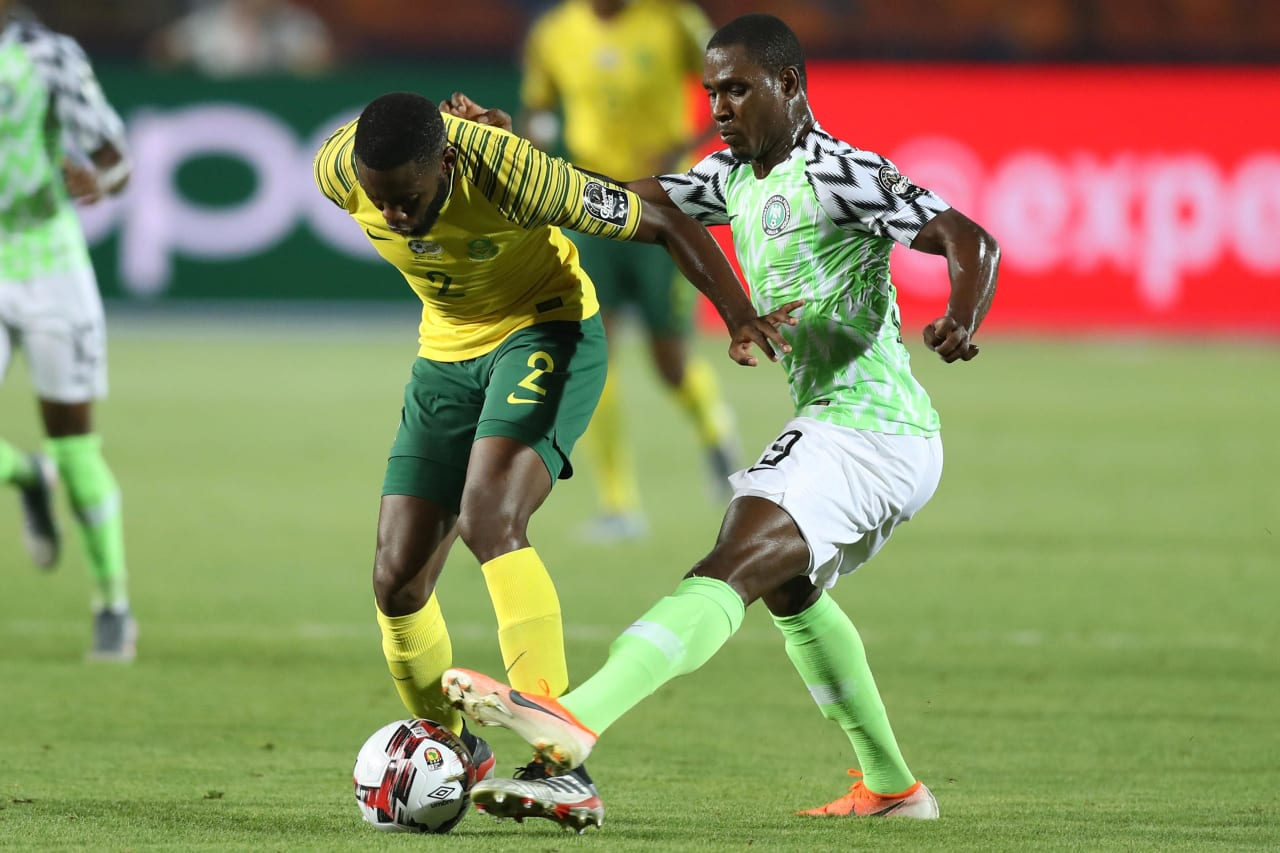 Buhle Mkhwanazi of South Africa challenged by Odion Jude Ighalo of Nigeria during the 2019 Africa Cup of Nations Finals, quarterfinals match between Nigeria and South Africa at Cairo International Stadium, Cairo, Egypt on 10 July 2019 ©Samuel Shivambu/BackpagePix