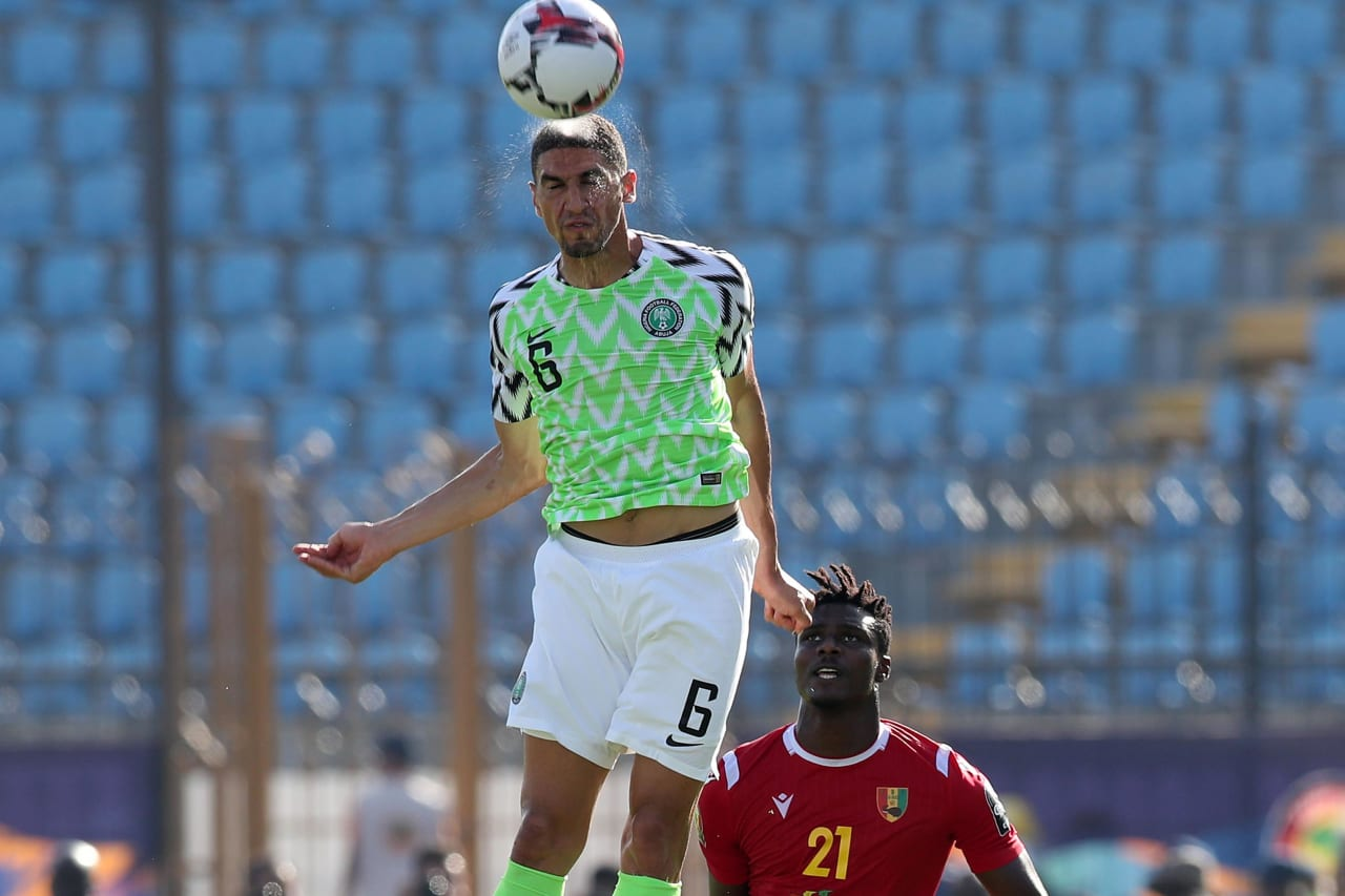 Leon Balogun of Nigeria clears ball from Sory Kaba of Guinea during the 2019 Africa Cup of Nations match between Nigeria and Guinea at the Alexandria Stadium, Alexandria on the 26 June 2019 ©Muzi Ntombela/BackpagePix