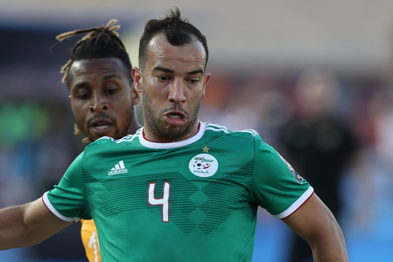 Djamel Benlamri of Algeria challenged by Wilfried Zaha of Ivory Coast during the 2019 Africa Cup of Nations Finals, quarterfinals match between Ivory Coast and Algeria at Suez Stadium, Suez, Egypt on 11 July 2019 ©Samuel Shivambu/BackpagePix
