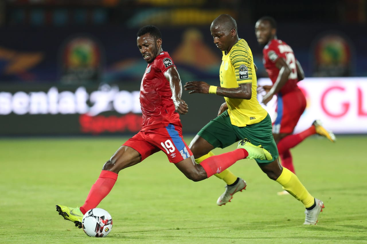 Benson Shilongo of Namibia shoots challenged by Thamsanqa Mkhize of South Africa during the 2019 Africa Cup of Nations Finals football match between South Africa and Namibia at the Al Salam Stadium, Cairo, Egypt on 28 June 2019 ©Gavin Barker/BackpagePix