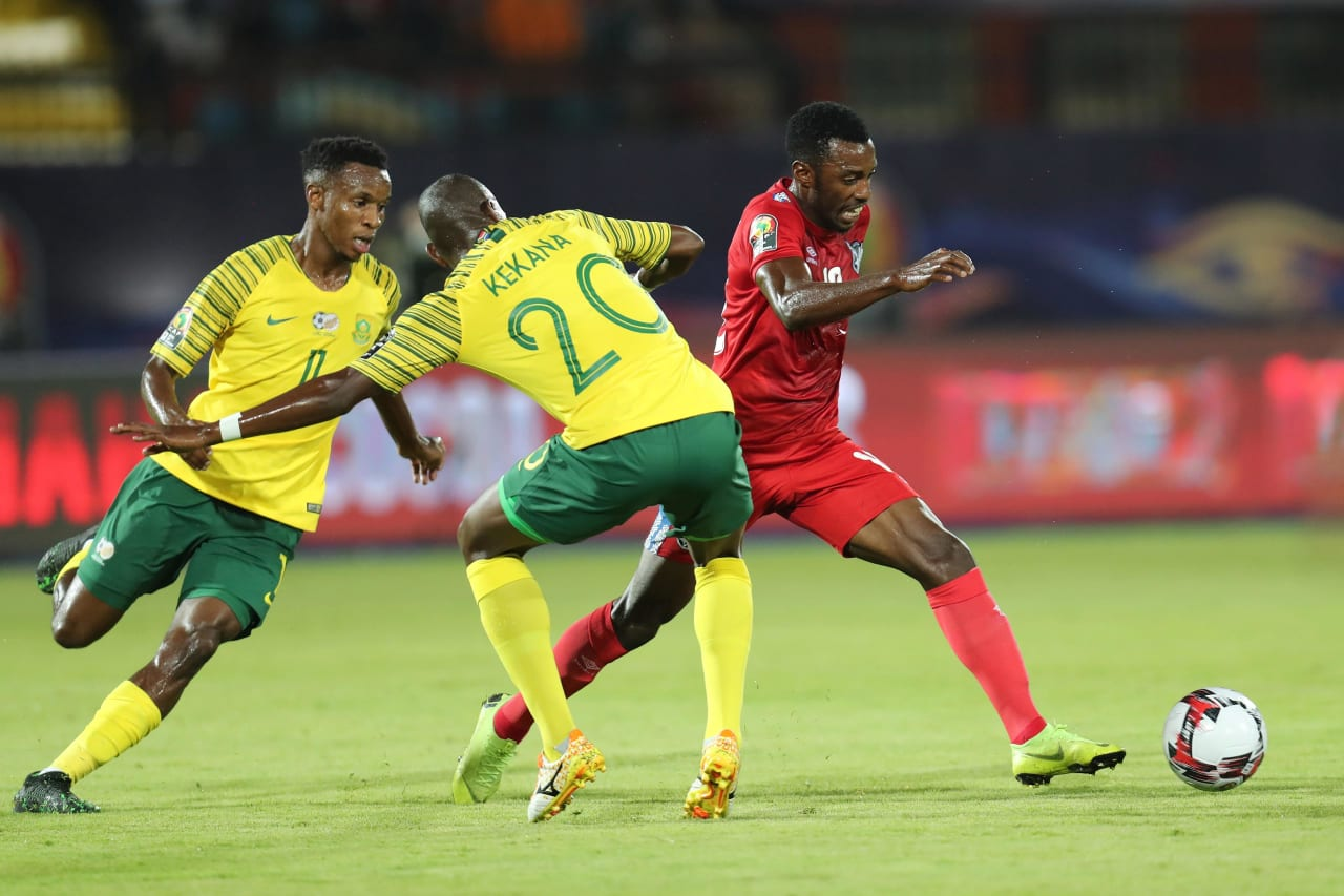 Petrus Shitembi of Namibia challenged by Hlompho Kekana of South Africa during the 2019 Africa Cup of Nations Finals football match between South Africa and Namibia at the Al Salam Stadium, Cairo, Egypt on 28 June 2019 ©Gavin Barker/BackpagePix