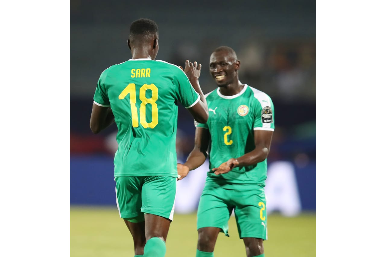 Ismaila Sarr of Senegal celebrates goal with teammate during the 2019 Africa Cup of Nations match between Kenya and Senegal at the 30 June Stadium, Cairo on the 01 July 2019