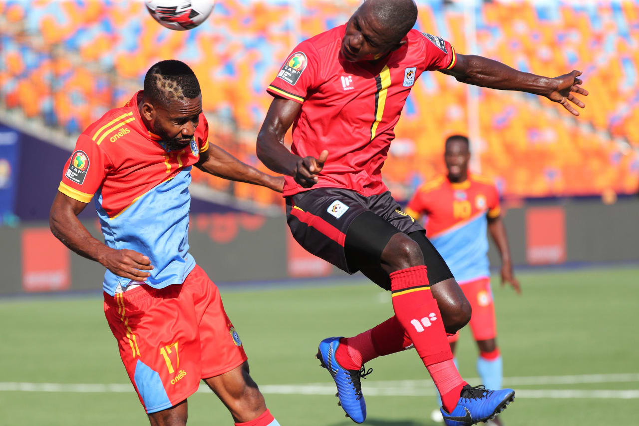 Patrick Kaddu of Uganda scores goal, challenged by Oarfait Mandanda of DR Congo during the 2019 Africa Cup of Nations Finals football match between DR Congo and Uganda  at the Cairo International Stadium, Cairo, Egypt on 22 June 2019 ©Gavin Barker/BackpagePix