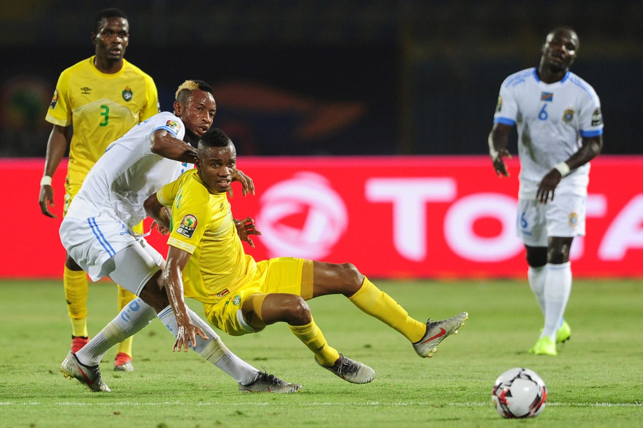 Ovidy Karuru of Zimbabwe is fouled by Jonathan Bolingi of DR Congo during the 2019 Africa Cup of Nations Finals game between Zimbabwe and DR Congo at 30 June Stadium in Cairo, Egypt on 30 June 2019 © Ryan Wilkisky/BackpagePix