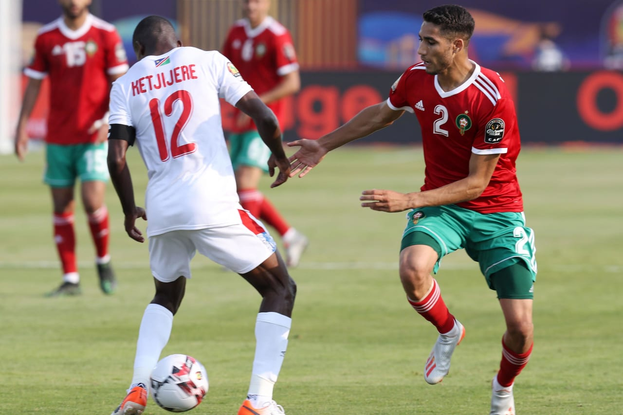 Ronald Ketjijere of Namibia challenged by Achraf Hakimi of Morocco during the 2019 Africa Cup of Nations Finals match between Morocco and Namibia at Training at Al-Salaam Stadium, Cairo, Egypt on 23 June 2019 ©Samuel Shivambu/BackpagePix