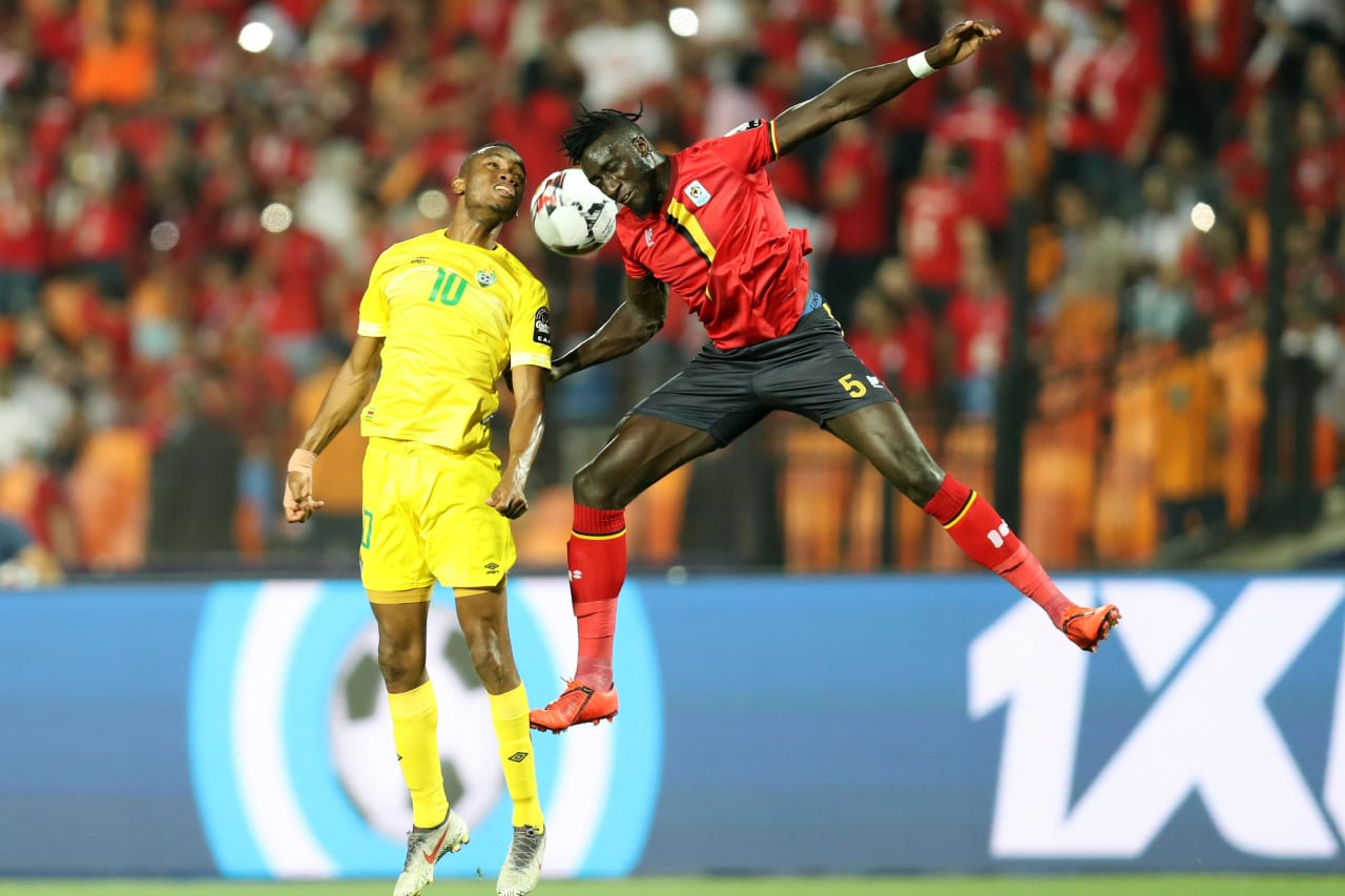 Ovidy Karuru of Zimbabwe challenged by Bevis Mugabi of Uganda during the 2019 Africa Cup of Nations Finals match between Uganda and Zimbabwe at Cairo International Stadium, Cairo, Egypt on 26 June 2019 ©Samuel Shivambu/BackpagePix