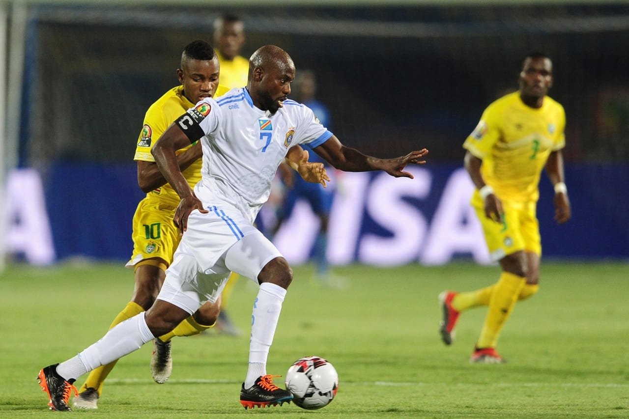 Mulumbu Yousuf of DR Congo takes on Ovidy Karuru of Zimbabwe during the 2019 Africa Cup of Nations Finals game between Zimbabwe and DR Congo at 30 June Stadium in Cairo, Egypt on 30 June 2019 © Ryan Wilkisky/BackpagePix