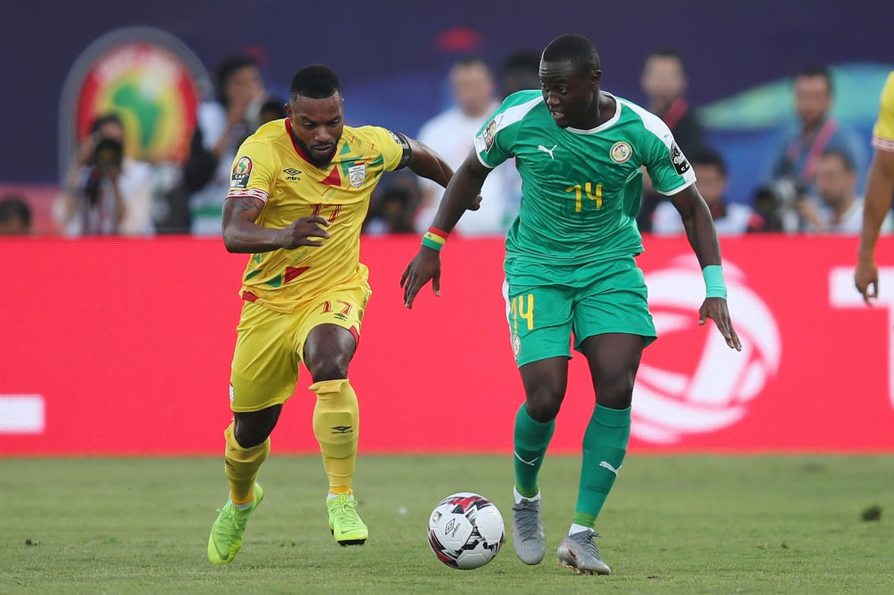 Henri Saivet of Senegal challenged by Moise Adilehou of Benin during the 2019 Africa Cup of Nations Quarterfinals match between Senegal and Benin at the 30 June Stadium, Cairo on the 10 July 2019 ©Muzi Ntombela/BackpagePix