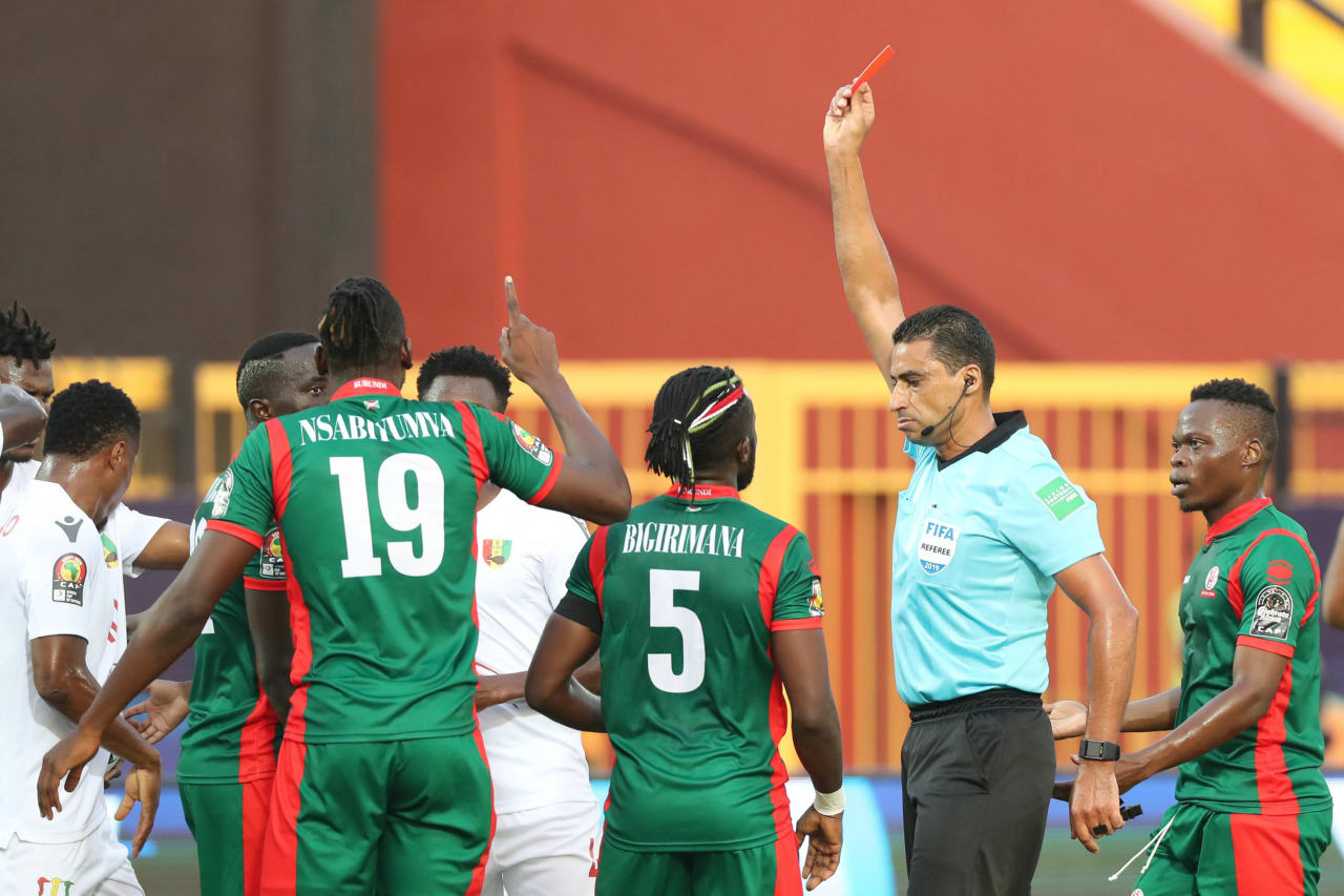 Nduwarugira Christophe of Burundi pulls back Mohamed Yattara of Guinea and is sent off vt referee Noureddine el Jaafari during the 2019 Africa Cup of Nations Finals football match between Burundi and Guinea at the Al Salam Stadium, Cairo, Egypt on 28 June 2019 ©Gavin Barker/BackpagePix