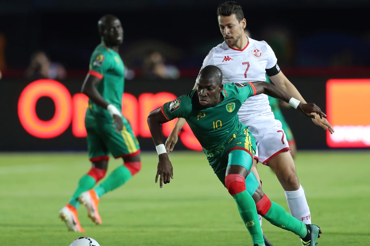 Adama Ba of Mauritania evades tackle from Youssef Msakni of Tunisia  during the 2019 Africa Cup of Nations Finals football match between Mauritania and Tunisia at the Suez Stadium, Suez, Egypt on 02 July 2019 ©Gavin Barker/BackpagePix