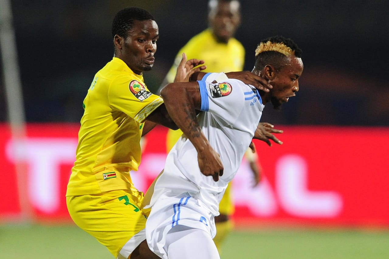 Jonathan Bolingi of DR Congo is fouled by Danny Phiri of Zimbabwe during the 2019 Africa Cup of Nations Finals game between Zimbabwe and DR Congo at 30 June Stadium in Cairo, Egypt on 30 June 2019 © Ryan Wilkisky/BackpagePix