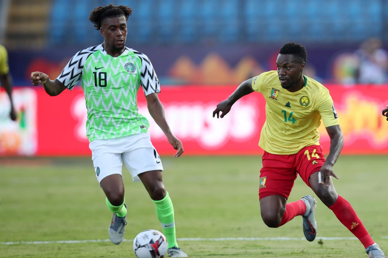 Georges Mandjeck of Cameroon challenged by Alexander Iwobi of Nigeria during the 2019 Africa Cup of Nations Last 16 match between Nigeria and Cameroon at the Alexandria Stadium, Alexandria on the 06 July 2019 ©Muzi Ntombela/BackpagePix