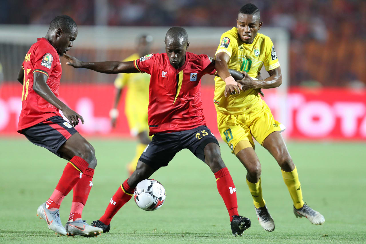 Faruku Miya and Michael Azira of Uganda challenged by Ovidy Karuru of Zimbabwe during the 2019 Africa Cup of Nations Finals match between Uganda and Zimbabwe at Cairo International Stadium, Cairo, Egypt on 26 June 2019 ©Samuel Shivambu/BackpagePix