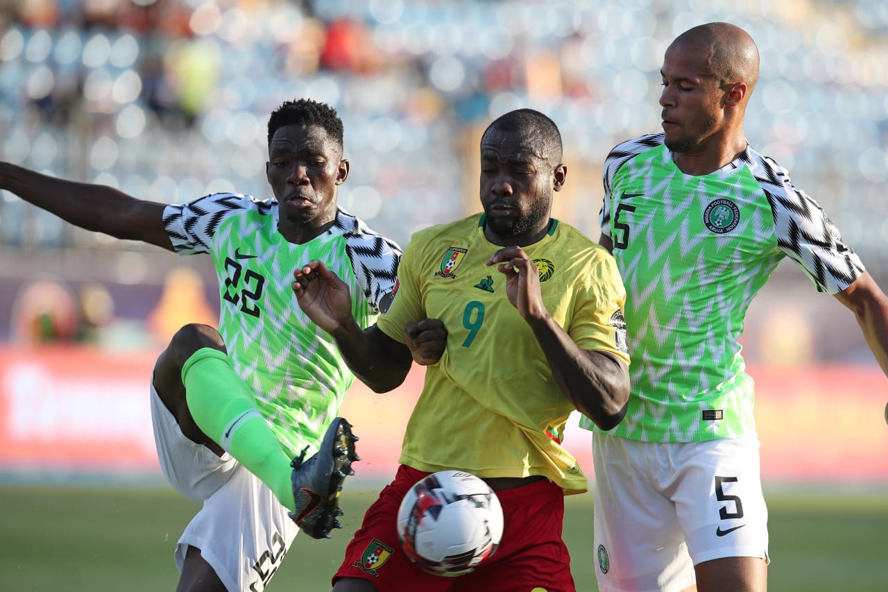 Stephane Bahoken of Cameroon challenged by Josiah Kenneth Omeruo (l) and William Paul Ekong of Nigeria during the 2019 Africa Cup of Nations Last 16 match between Nigeria and Cameroon at the Alexandria Stadium, Alexandria on the 06 July 2019 ©Muzi Ntombela/BackpagePix