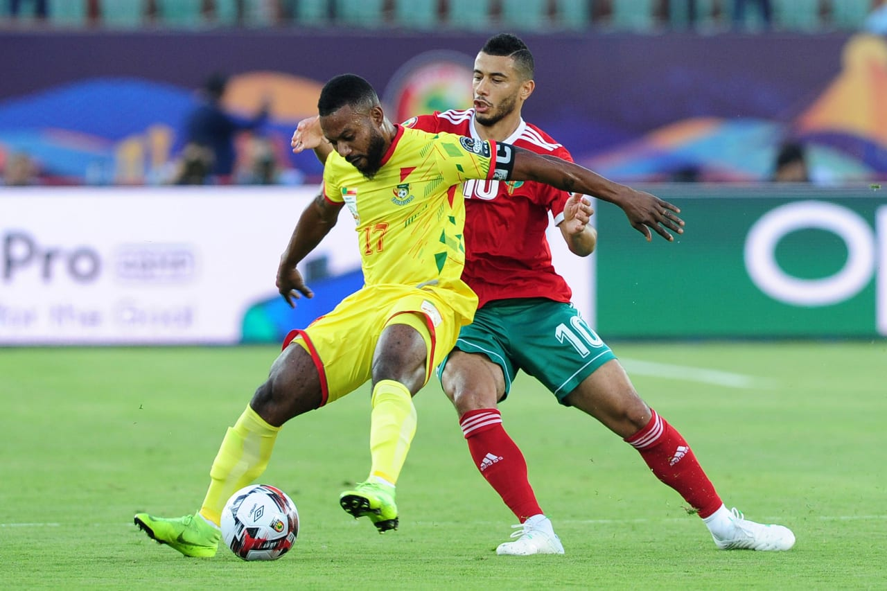 Stephane Sessegnon of Benin is challenged by Younes Belhanda of Morocco during the 2019 Africa Cup of Nations Finals last 16 match between Morocco and Benin at the Al Salam Stadium in Cairo, Egypt on 05 July 2019 © Ryan Wilkisky/BackpagePix
