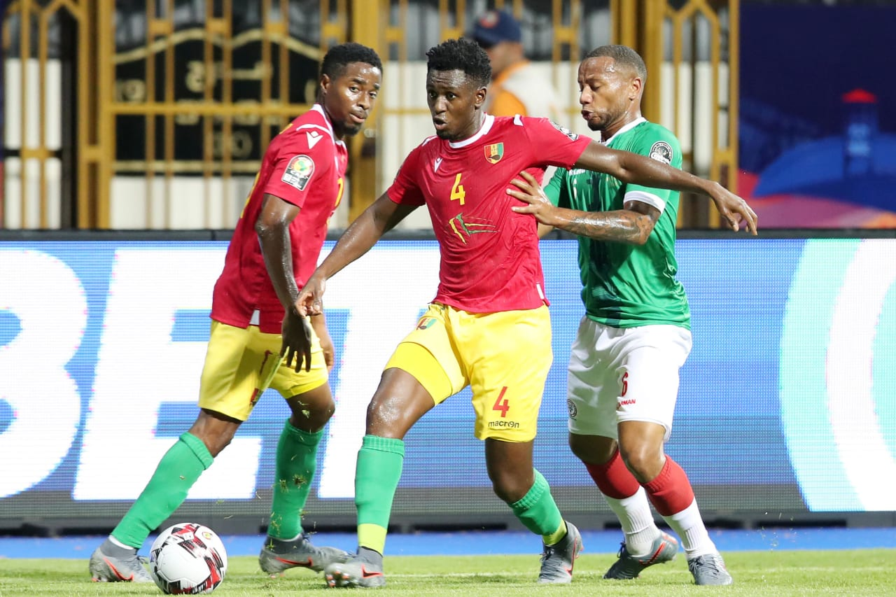 Amadou Diawara of Guinea challenged by Marco Ilaiharitra of Madagascar during the 2019 Africa Cup of Nations Finals match between Guinea and Madagascar at the Alexandria Stadium, Alexandria on the 22 June 2019 ©Muzi Ntombela/BackpagePix