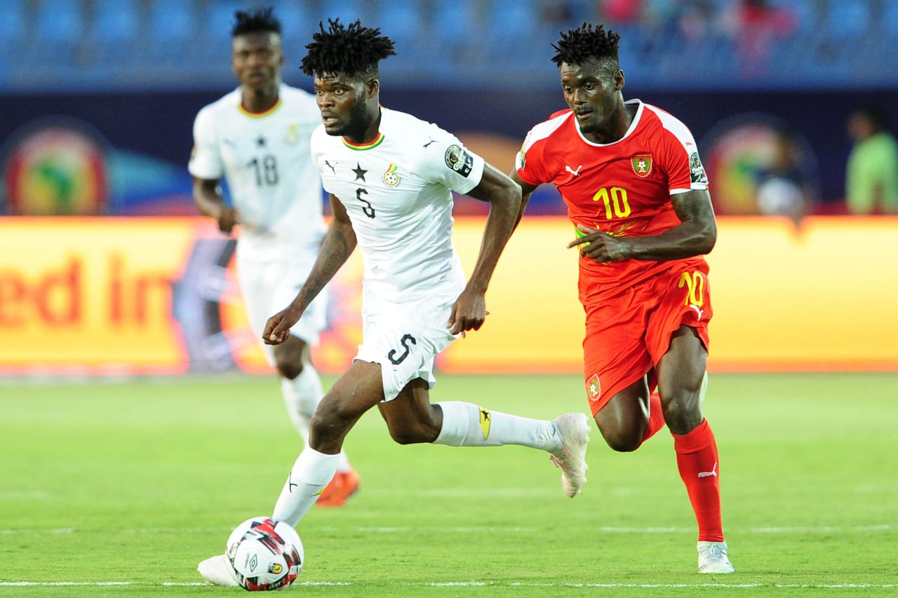 Thomas Teye Partey of Ghana pulls away from Judilson Pele Gomes of Guinea-Bissau during the 2019 Africa Cup of Nations Finals football match between Guinea Bissau and Ghana at the Suez Stadium, Suez, Egypt on 02 July 2019 © Ryan Wilkisky/BackpagePix