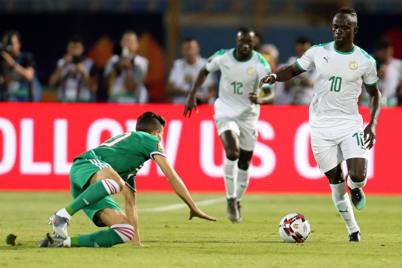 Sadio Mane of Senegal challenged by Youcef Atal of Algeria during the 2019 Africa Cup of Nations Finals match between Senegal and Algeria at 30 June Stadium, Cairo, Egypt on 27 June 2019 ©Samuel Shivambu/BackpagePix
