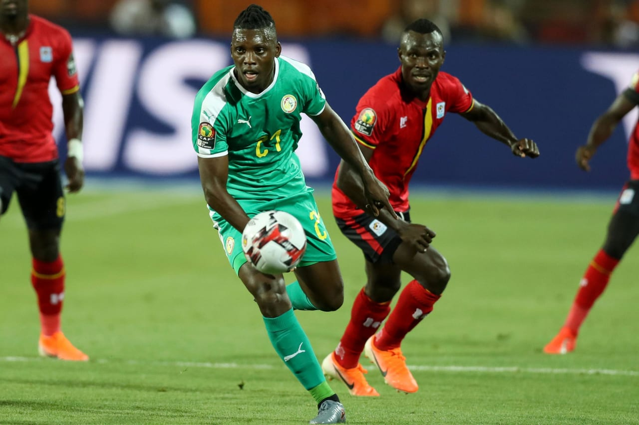 Lamine Gassama of Senegal challenged by Emmanuel Okwi of Uganda during the 2019 Africa Cup of Nations Finals last 16 match between Uganda and Senegal at Cairo International Stadium, Cairo, Egypt on 05 July 2019 ©Samuel Shivambu/BackpagePix