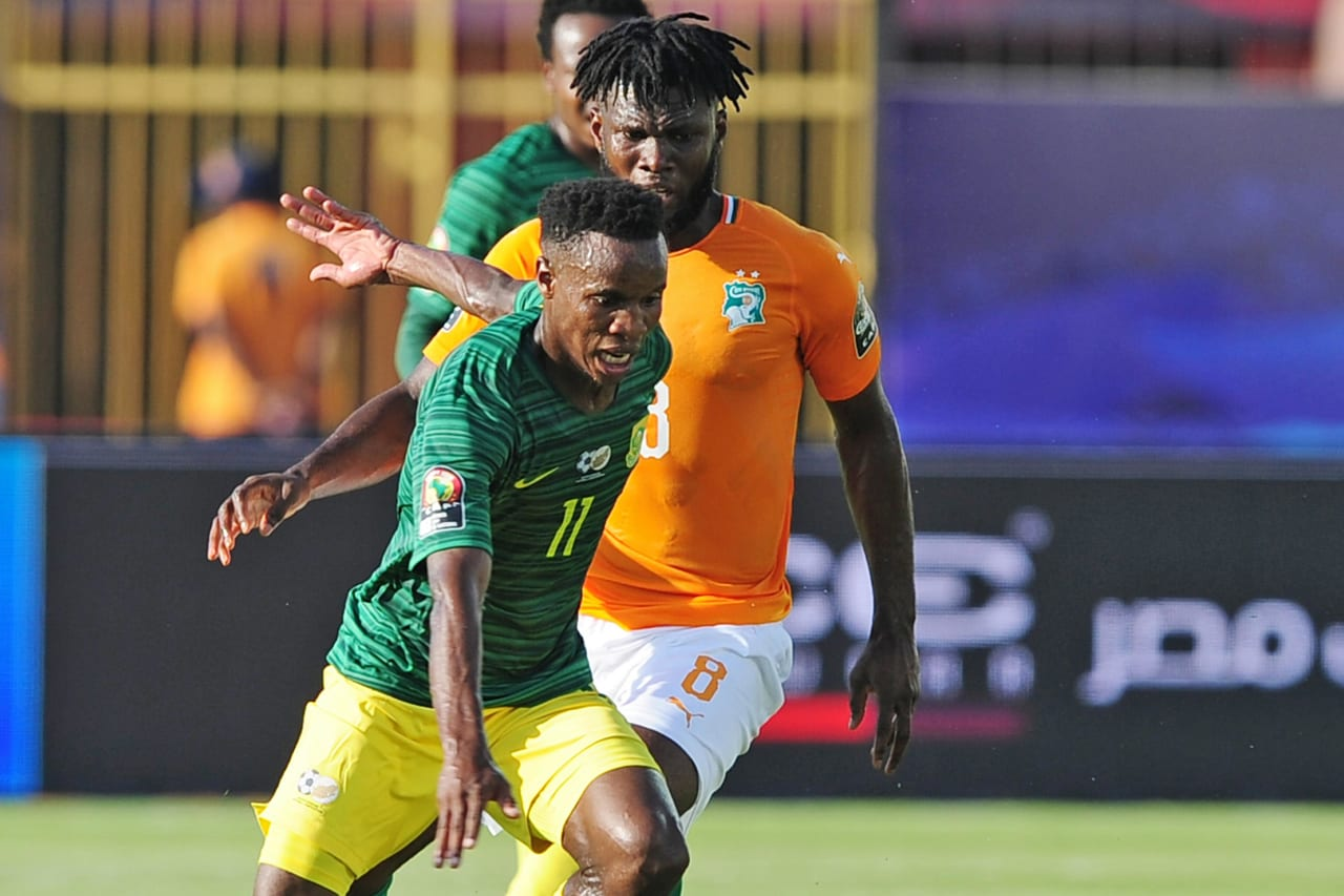 Themba Zwane of South Africa is challenged by Franck Kessie of Ivory Coast during the 2019 Africa Cup of Nations Finals game between Ivory Coast and South Africa at Al Salam Stadium in Cairo, Egypt on 24 June 2019 © Ryan Wilkisky/BackpagePix