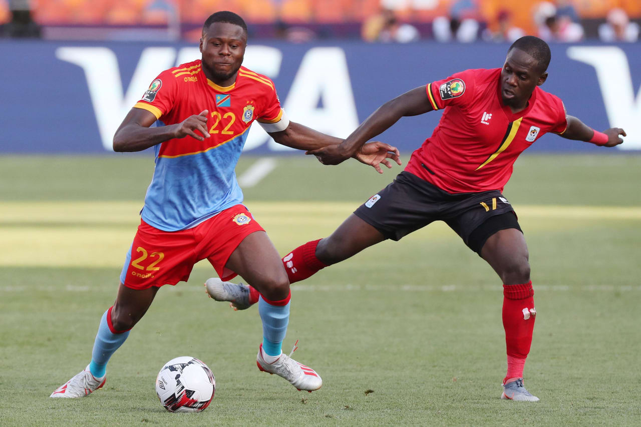 Chancel Mangulu Mbemba of DR Congo challenged by Faruku Miya of Uganda during the 2019 Africa Cup of Nations Finals football match between DR Congo and Uganda  at the Cairo International Stadium, Cairo, Egypt on 22 June 2019 ©Gavin Barker/BackpagePix