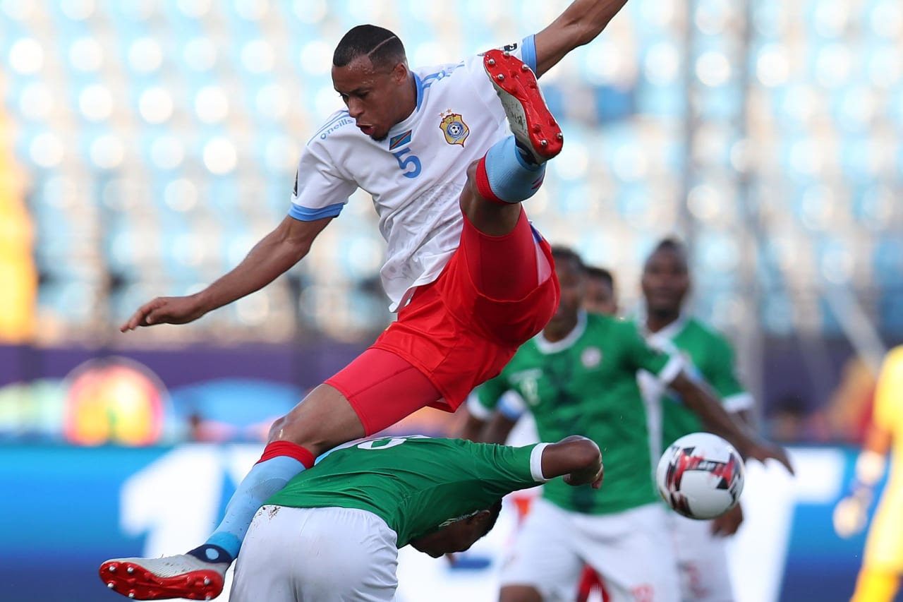 Marcel Tisserand of DR Congo fouled by Lalaina Henintsoa Enjanahary of Madagascar during the 2019 Africa Cup of Nations Last 16 match between Madagascar and DR Congo at the Alexandria Stadium, Alexandria on the 07 July 2019 ©Muzi Ntombela/BackpagePix