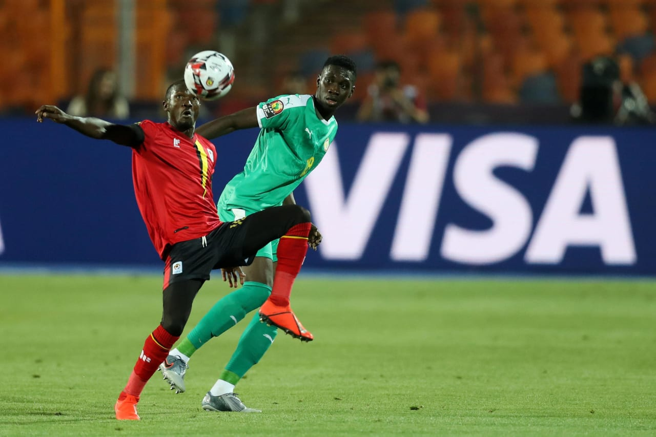 Godfrey Walusimbi of Uganda challenged by Ismaila Sarr of Senegal during the 2019 Africa Cup of Nations Finals last 16 match between Uganda and Senegal at Cairo International Stadium, Cairo, Egypt on 05 July 2019 ©Samuel Shivambu/BackpagePix