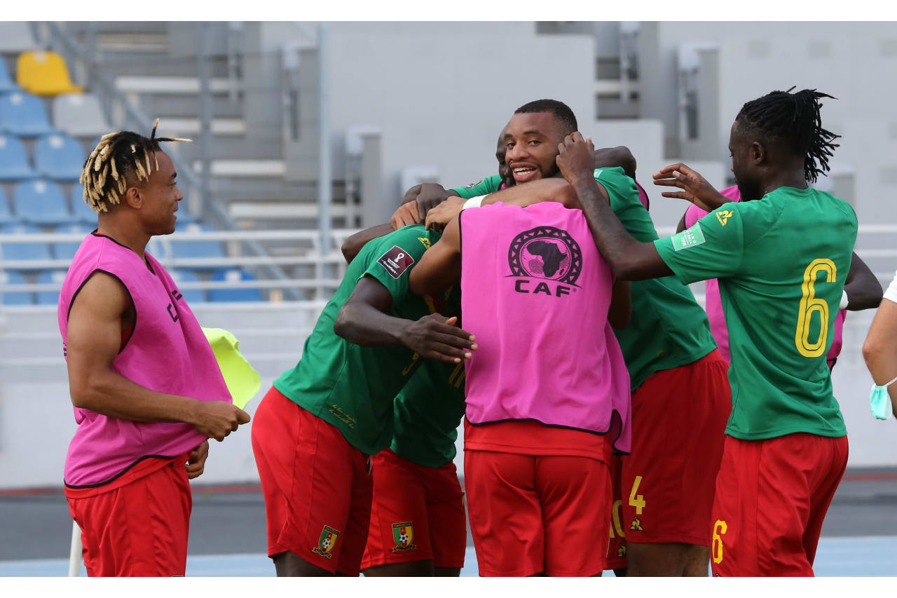 Cameroon players celebrate a goal scored by Michael Ngadeu-Ngadjui of Cameroon during the Qatar 2022 FIFA World Cup Qualifier between Mozambique and Cameroon at Grand Stade De Tanger in Morocco on 11 October 2021