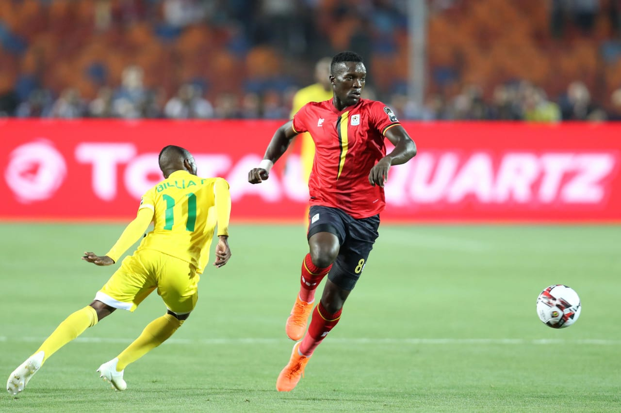 Khalid Aucho of Uganda challenged by Khama Billiat of Zimbabwe during the 2019 Africa Cup of Nations Finals match between Uganda and Zimbabwe at Cairo International Stadium, Cairo, Egypt on 26 June 2019 ©Samuel Shivambu/BackpagePix