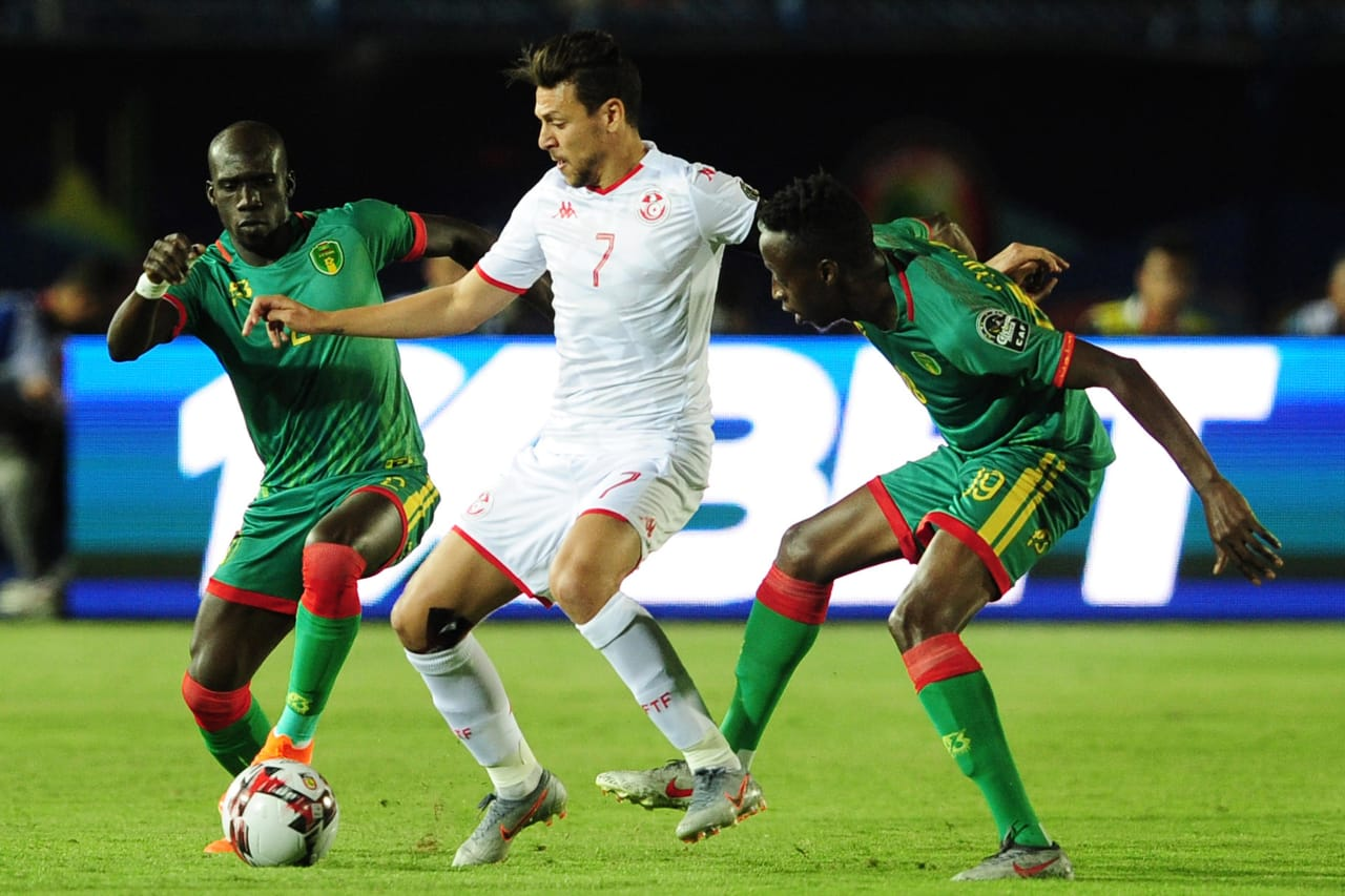 Youssef Msakni of Tunisia is challenged by Ibrahima Coulibaly and El Mostapha Diaw of Mauritania during the 2019 Africa Cup of Nations Finals football match between Mauritania and Tunisia at the Suez Stadium, Suez, Egypt on 02 July 2019 © Ryan Wilkisky/BackpagePix