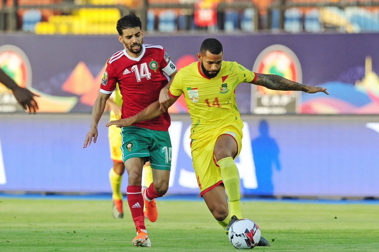 Cebio Soukou of Benin is challenged by Mbark Boussoufa of Morocco during the 2019 Africa Cup of Nations Finals last 16 match between Morocco and Benin at the Al Salam Stadium in Cairo, Egypt on 05 July 2019 © Ryan Wilkisky/BackpagePix