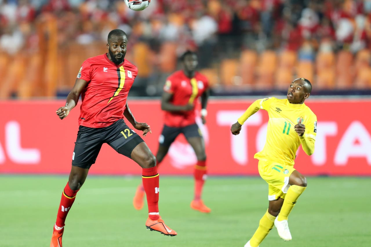 Ronald Mukiibi of Uganda challenged by Khama Billiat of Zimbabwe during the 2019 Africa Cup of Nations Finals match between Uganda and Zimbabwe at Cairo International Stadium, Cairo, Egypt on 26 June 2019 ©Samuel Shivambu/BackpagePix