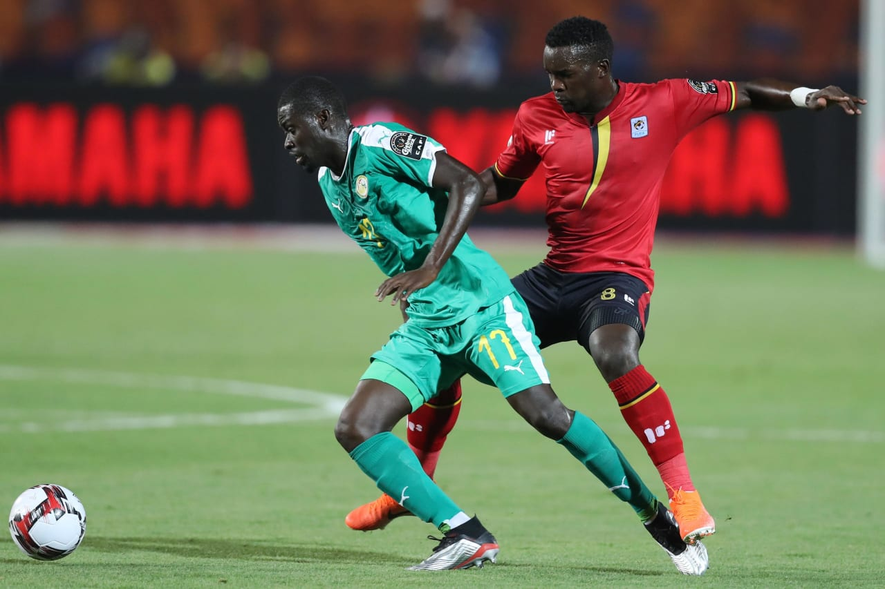 Papa Alioune Ndiaye of Senegal challenged by Khalid Aucho of Uganda during the 2019 Africa Cup of Nations Finals last 16 match between Uganda and Senegal at Cairo International Stadium, Cairo, Egypt on 05 July 2019 ©Samuel Shivambu/BackpagePix