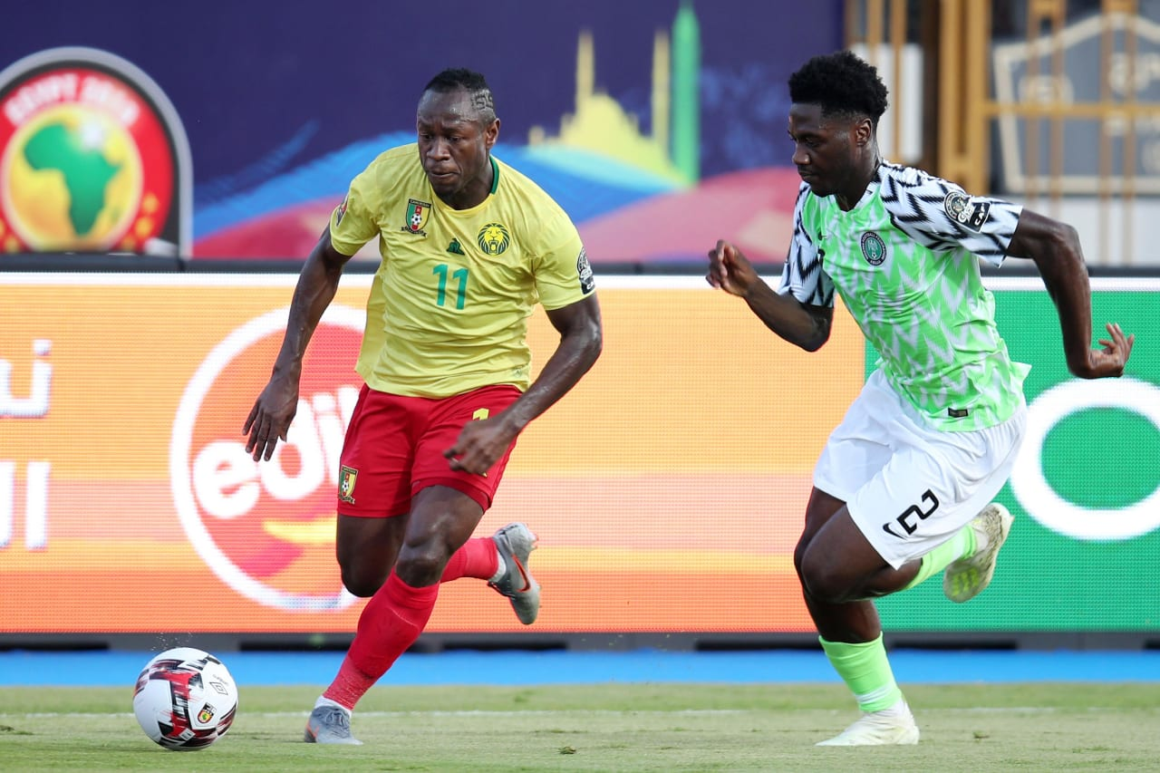 Christian Bassogog of Cameroon challenged by Temitayo Olufisayo Aina of Nigeria during the 2019 Africa Cup of Nations Last 16 match between Nigeria and Cameroon at the Alexandria Stadium, Alexandria on the 06 July 2019 ©Muzi Ntombela/BackpagePix