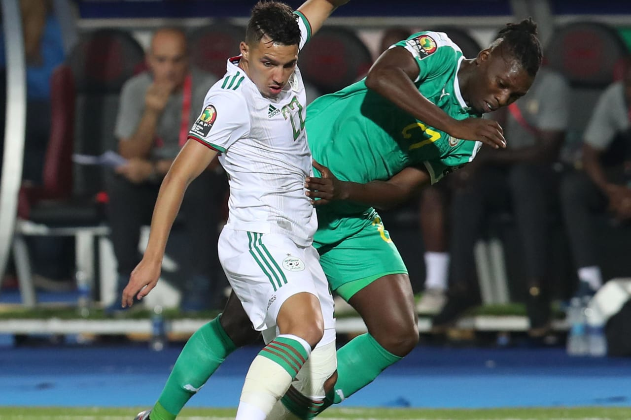 Ismael Bennacer of Algeria challenged by Lamine Gassama of Senegal during the 2019 Africa Cup of Nations Final match between Senegal and Algeria at the Cairo International Stadium, Cairo on the 19 July 2019 ©Muzi Ntombela/BackpagePix