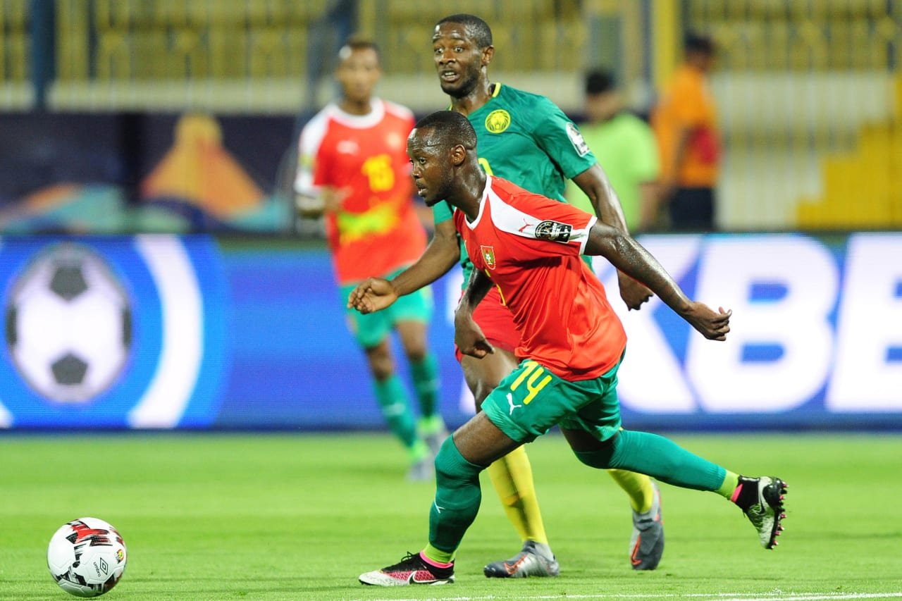 Arnaud Djoum of Cameroon gets his pass away as Juary Marinho Soares of Guinea-Bissau looks on during the 2019 Africa Cup of Nations Finals game between Cameroon and Guinea-Bissau at Ismailia Stadium in Ismailia, Egypt on 25 June 2019 © Ryan Wilkisky/BackpagePix
