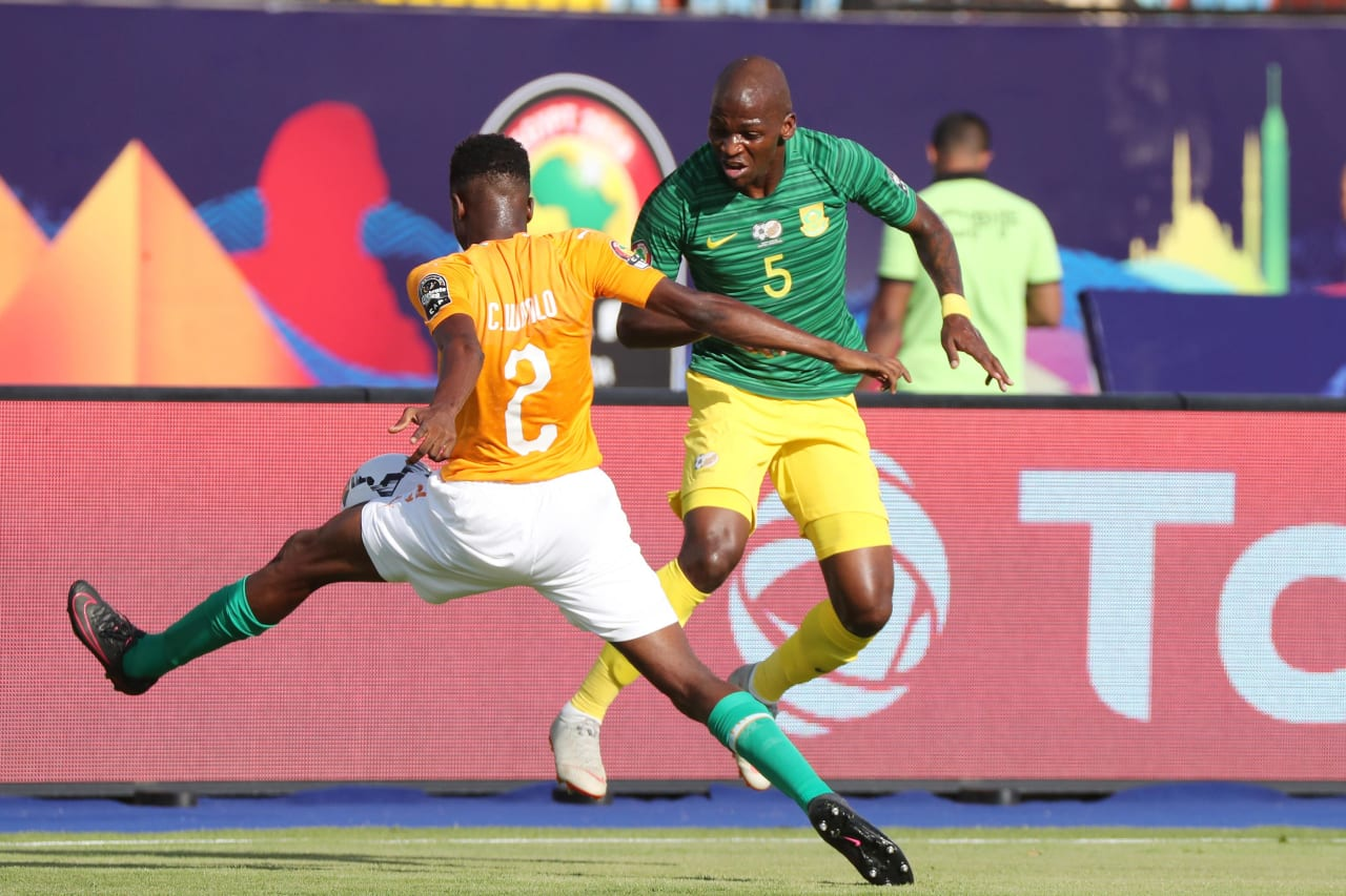 Thamsanqa Mkhize of South Africa tackled by Wonlo Coulibaly of Ivory Coast during the 2019 Africa Cup of Nations Finals football match between Ivory Coast and South Africa at the Al Salaam Stadium, Cairo, Egypt on 24 June 2019 ©Gavin Barker/BackpagePix