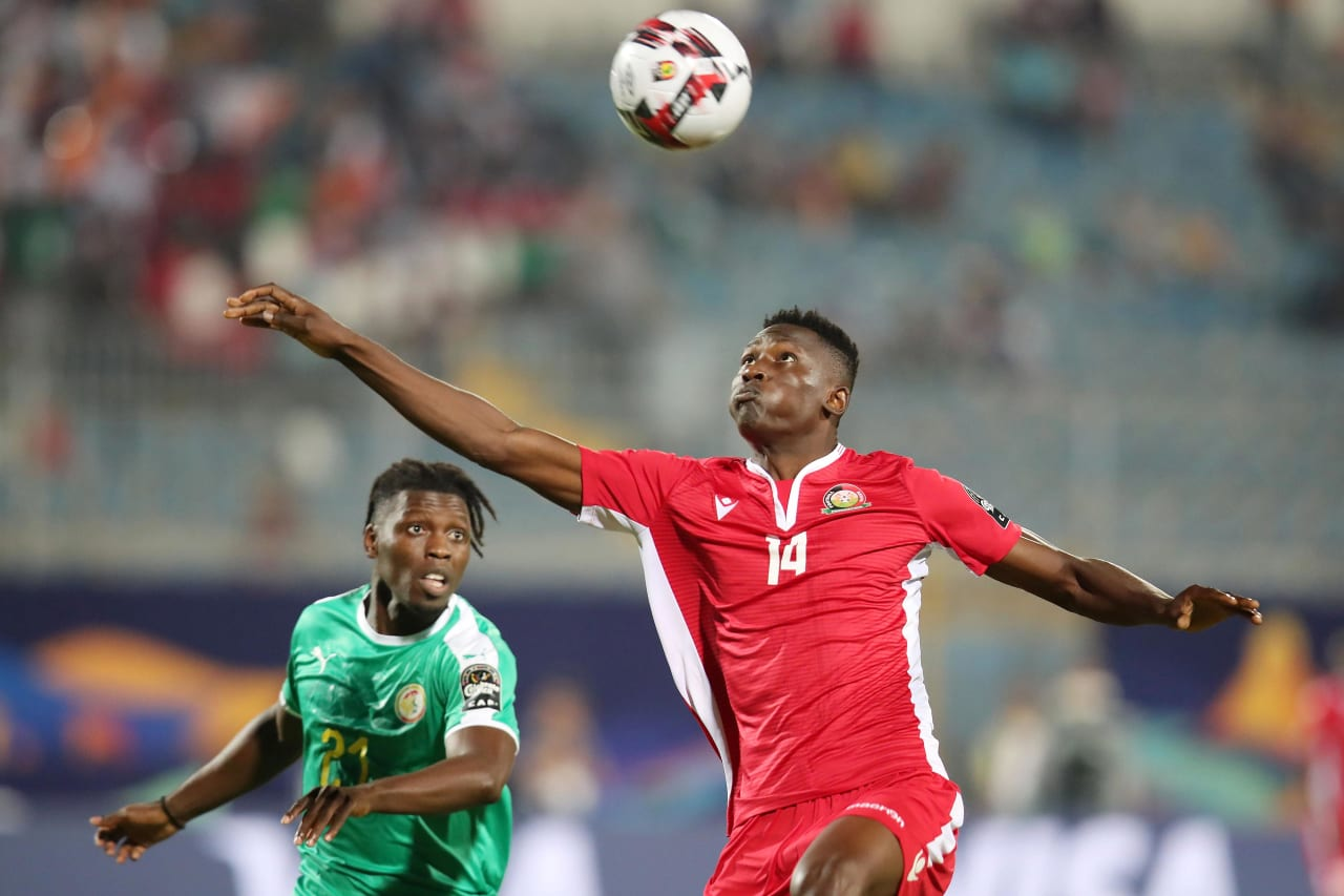 Michael Olunga of Kenya challenged by Lamine Gassama of Senegal during the 2019 Africa Cup of Nations match between Kenya and Senegal at the 30 June Stadium, Cairo on the 01 July 2019 ©Muzi Ntombela/BackpagePix