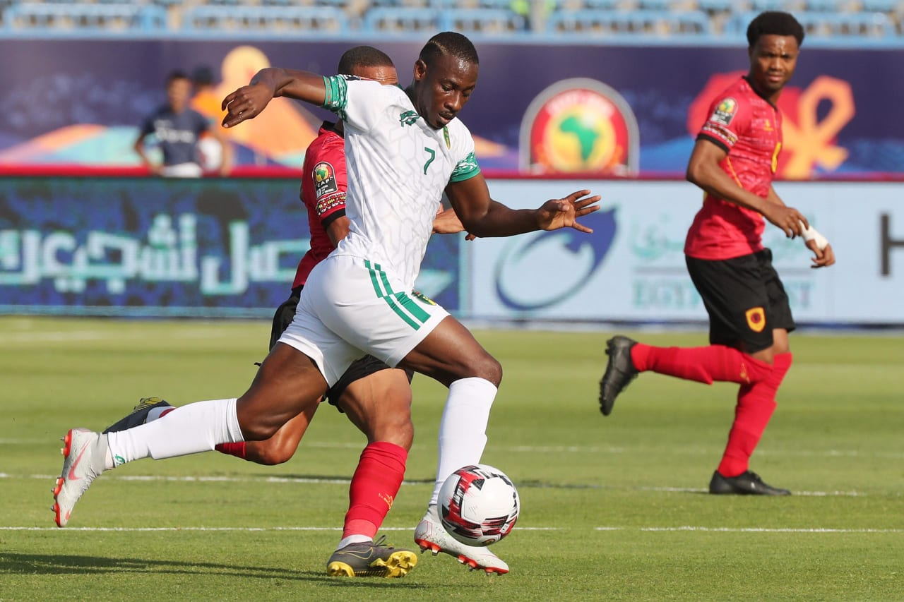 Ismael Diakite of Mauritania challenged by Bruno Gaspar of Angola during the 2019 Africa Cup of Nations Finals football match between Mauritania and Angola  at the Suez Stadium, Suez, Egypt on 29 June 2019 ©Gavin Barker/BackpagePix